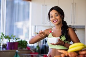 A young and fit woman eating healthy